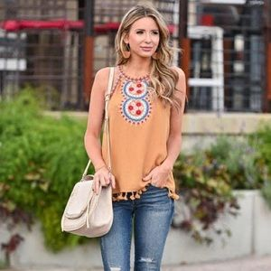 Embroidered sleeveless top in mustard